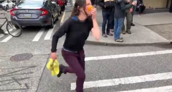 Unhinged Protester From CHAZ Wears Orange Peel as Face Mask, Punches Person Recording Her (VIDEO)