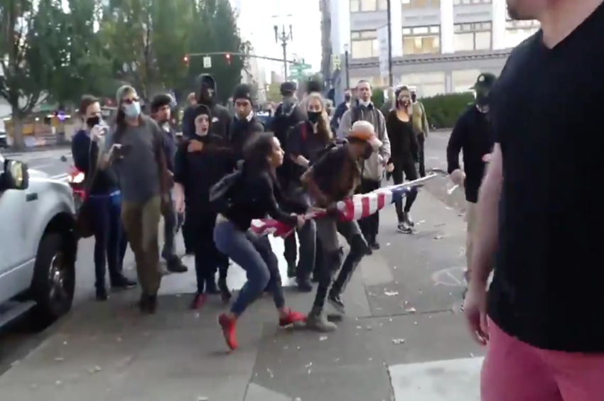 Viral video reportedly shows antifa members trying to rip American flag from woman's hands in Portland